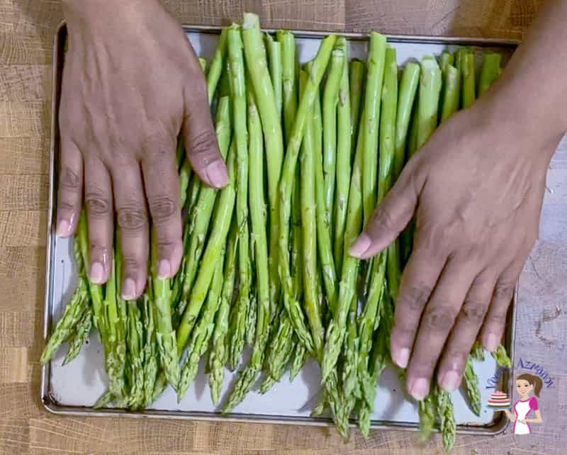 Place the asparagus on the baking tray for roasting
