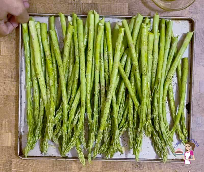 Place the asparagus on a baking tray
