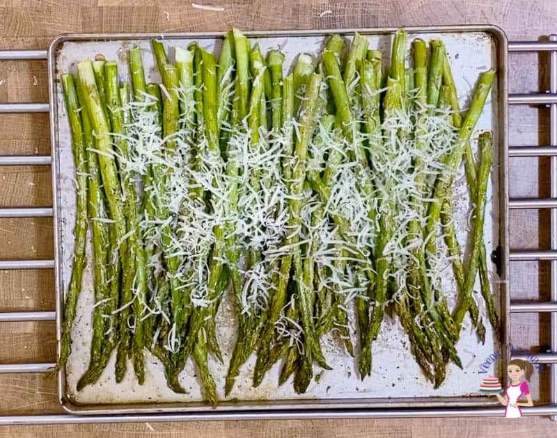 Grate the parmesan on the asparagus
