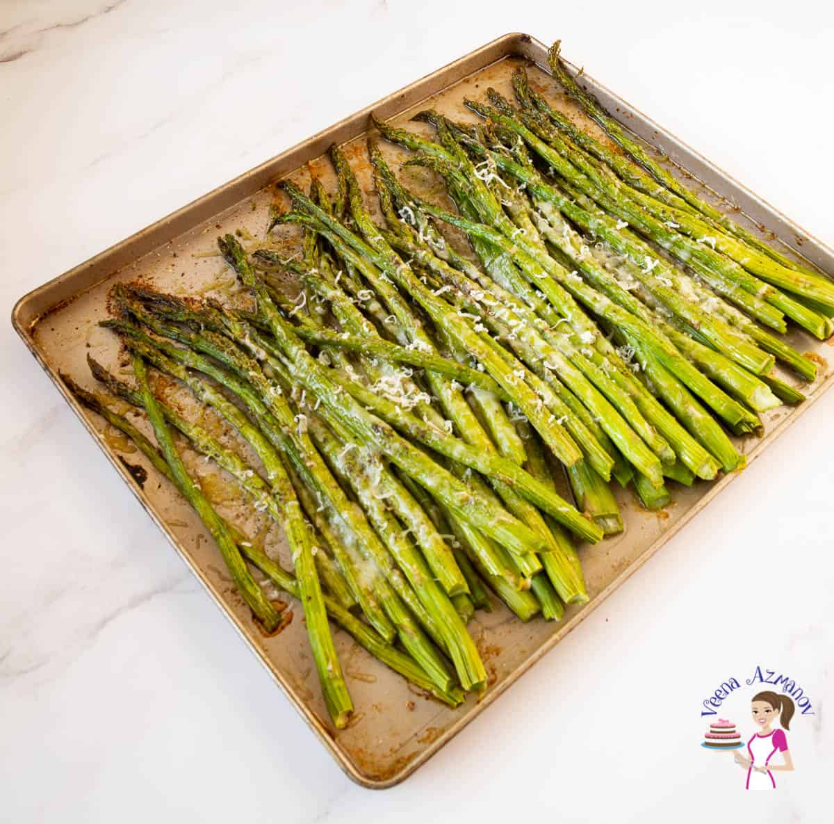 baked asparagus on a baking tray