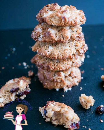 A stack of cranberry cookies on a table.