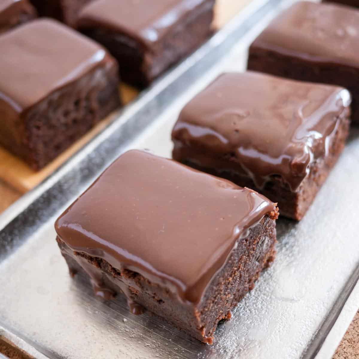 Chocolate fudge brownies on a tray.