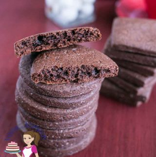A stack of chocolate cookies on a table.