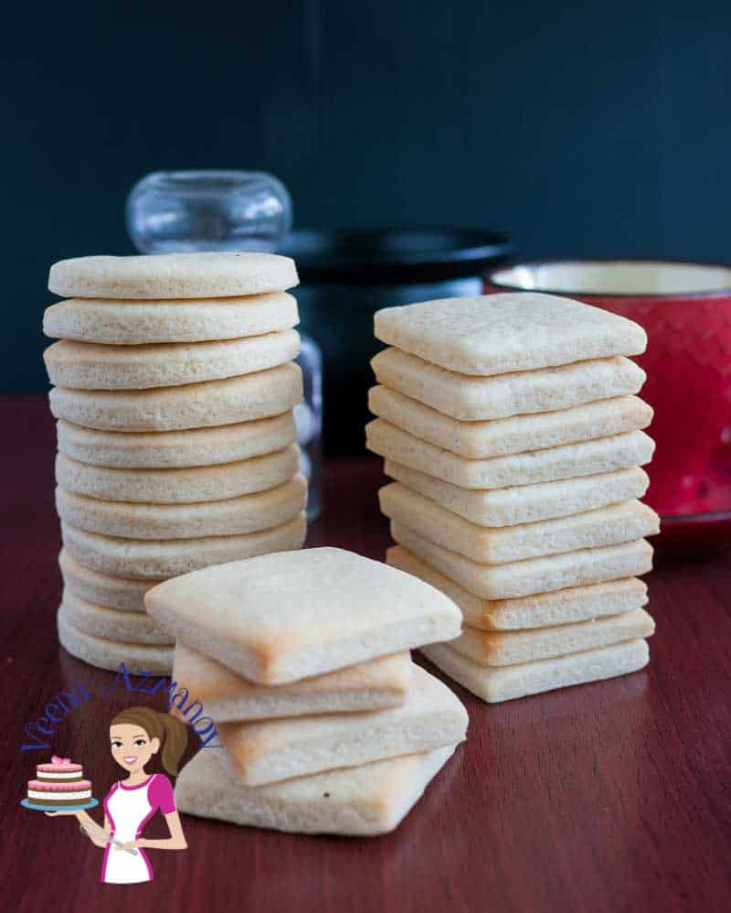 These eggless vanilla sugar cookies are light, airy with a shortbread texture that just melt in the mouth. A simple, easy and effortless recipe that will have you bake these cookies in less than thirty minutes whether you baking just for a daily tea time snack or to give away as a gifts during holidays.