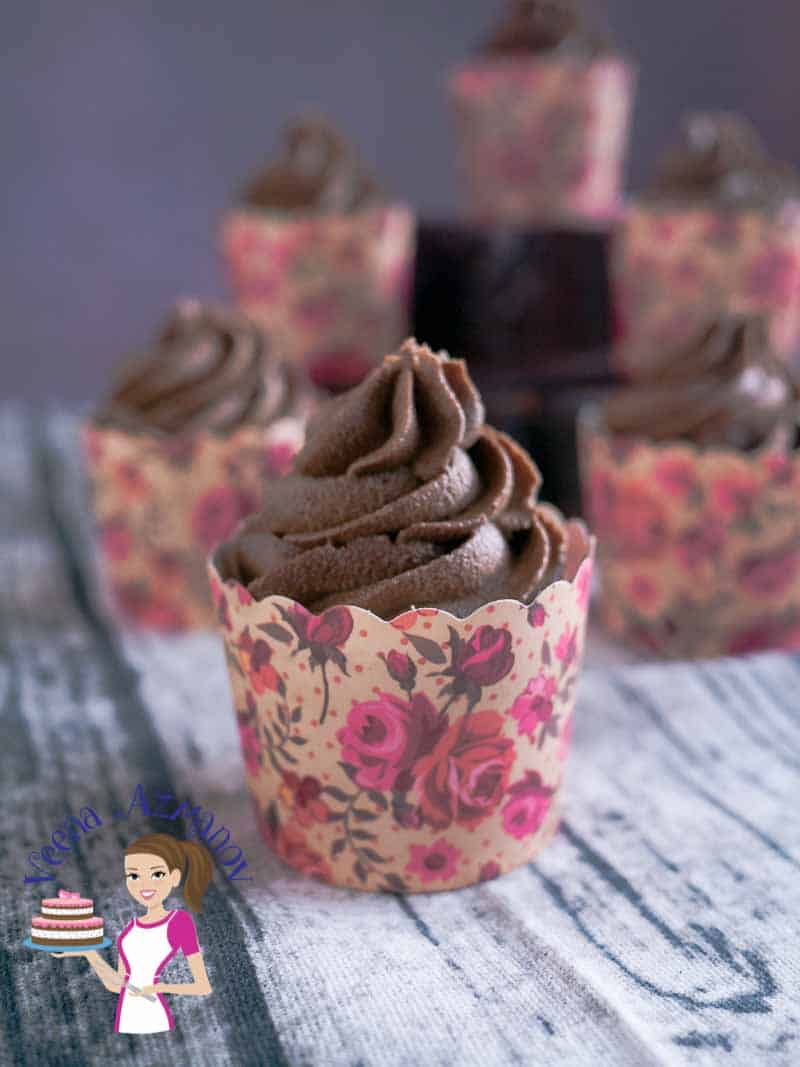 These old fashioned gingerbread cupcakes are perfect for the cold weather. Flavored with warm spices such cinnamon, ginger, nutmeg; along with the rich and robust flavor of molasses then topped with an equally delicious melt in the mouth chocolate fudge frosting. These make perfect food gift ideas or treats for the holiday celebrations.