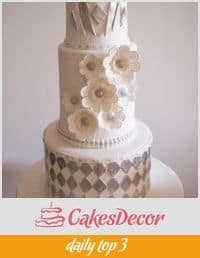 A wedding cake decorated in an Art Deco theme.