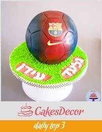 A cake decorated to look like a Barcelona football.