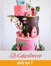 A cake decorated to look like an enchanted treehouse.