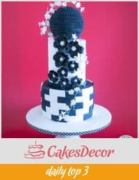 A wedding cake decorated in a black and white theme.