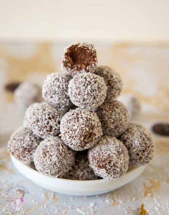 A stack of coconut chocolate balls in a small plate.