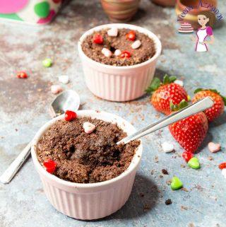 Chocolate fudge cake in a ramekin with a spoon.