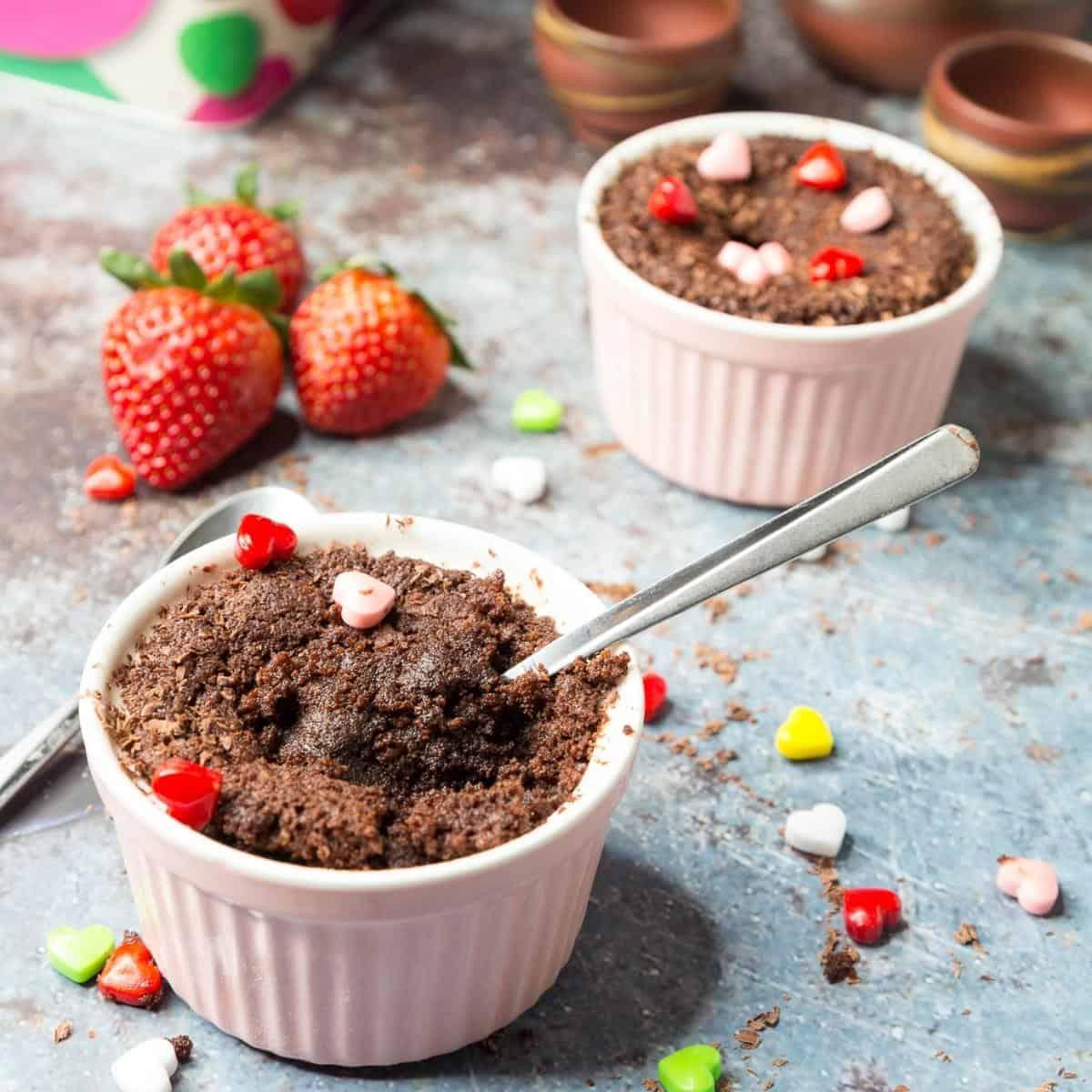 Two ramekins with chocolate fudge cake