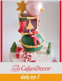A cake decorated in a Christmas theme.