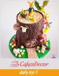 A cake decorated like a tree stump.