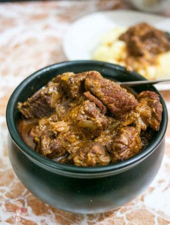 This slow cooked beef goulash is a simple, easy and effortless recipe that produces fork tender, melt in the mouth meat that's richly flavored with garlic, cloves and caraway before slow cooking for hours. Traditionally served with noodles but goes equally well with mashed potatoes or steamed rice.