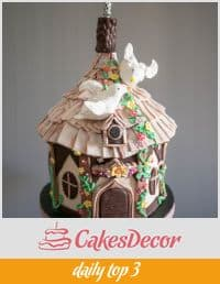 A cake decorated to look like a bird house.