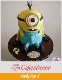 A cake decorated to look like one of the minions from the Despicable Me movie.