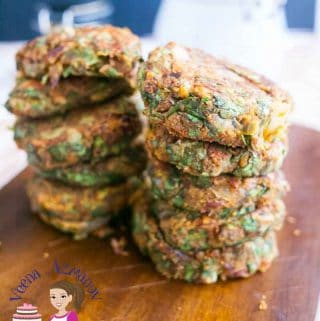 A stack of Swiss chard patties on a board.