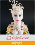 A cake sculpted to look like a lady of the sea.
