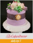 A wedding cake designed lavender color with lace.