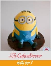 A cake designed to look like one of the minions from the Despicable Me movie.