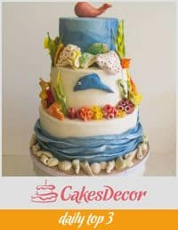 A cake decorated with an ocean theme.