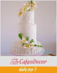 A wedding cake decorated with sugar orchids.
