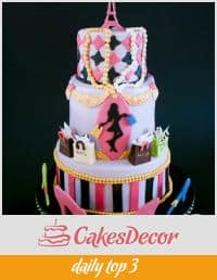 A caked decorated in a Paris fashion theme.