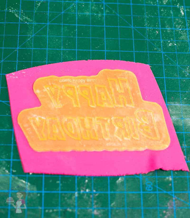 Making letters out of gum paste.