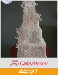 A wedding cake decorated in a snowflake theme.
