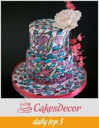 A cake decorated with a stained glass design.