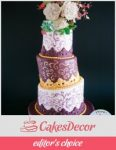 A cake decorated in a topsy turvy theme.
