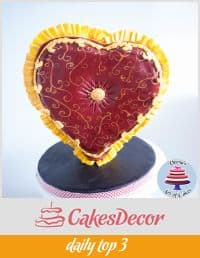 A cake decorated to look like a heart-shaped pillow.