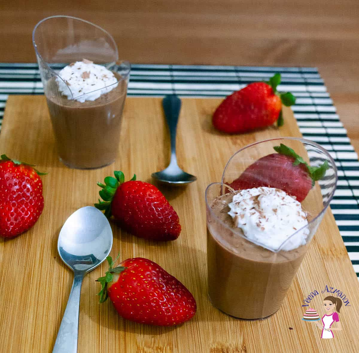 Chocolate mousse and strawberries on a wooden board