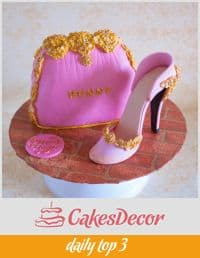 A cake decorated to look like a woman's handbag and stiletto.