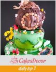 A cake decorated to look like a woodland fairy house.