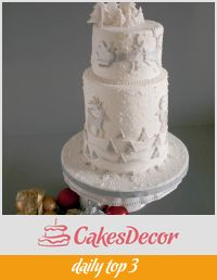 A wedding cake decorated in a winter theme.