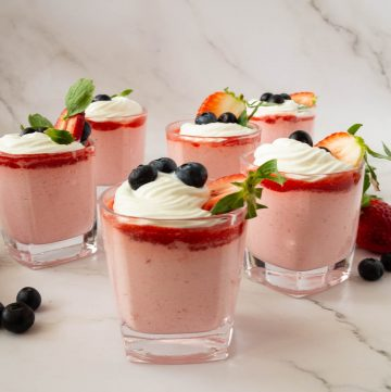 Six glasses with strawberry mousse