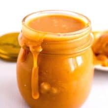 A mason jar with golden caramel filling.