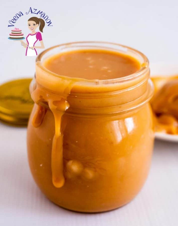 A glass jar with caramel sauce.