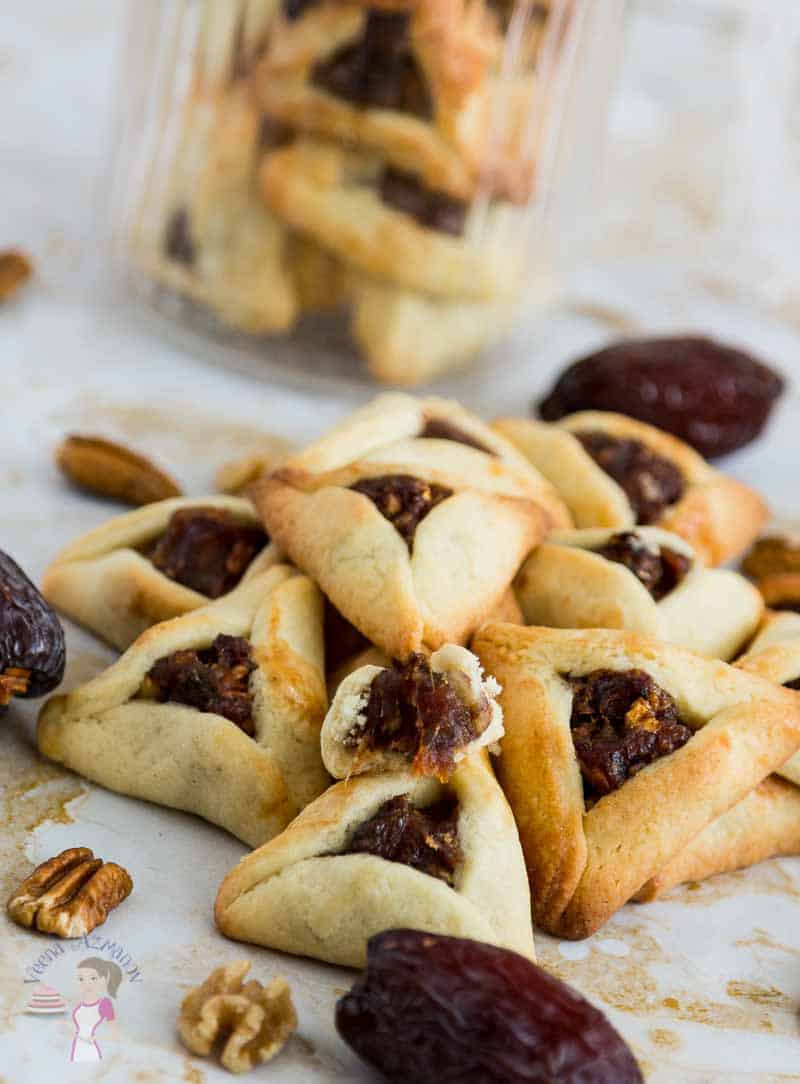 Image showing the inside soft date filling in the dates purim cookies aka dates filled purim cookies aka Ozen Haman or Hamentaschen.