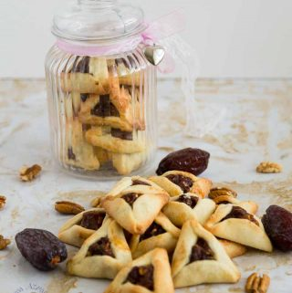 Hamentaschen cookies are the highlight of Purim but traditional purim cookies are not eggless or dairy free which can be a disappointment for those with allergies. This simple, easy and effortless recipe for dairy free and eggless hamentaschen cookies can be made with any filling but today we have strawberry filled purim cookies.