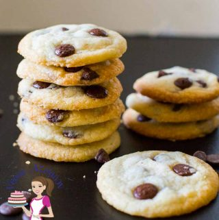 A stack of chocolate chip cookies on a table.