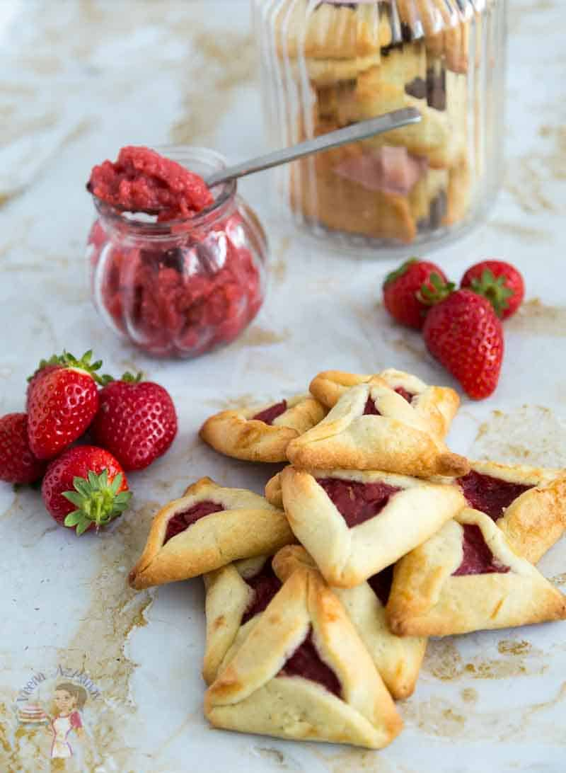 Hamantaschen cookies are the highlight of Purim but traditional purim cookies are not eggless or dairy free which can be a disappointment for those with allergies. This simple, easy and effortless recipe for dairy free and eggless hamentaschen cookies can be made with any filling but today we have strawberry filled purim cookies.