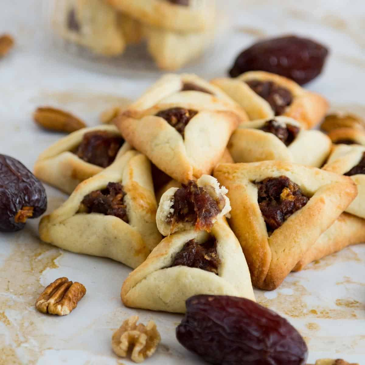Hamantaschen cookies filled with dates and pecans