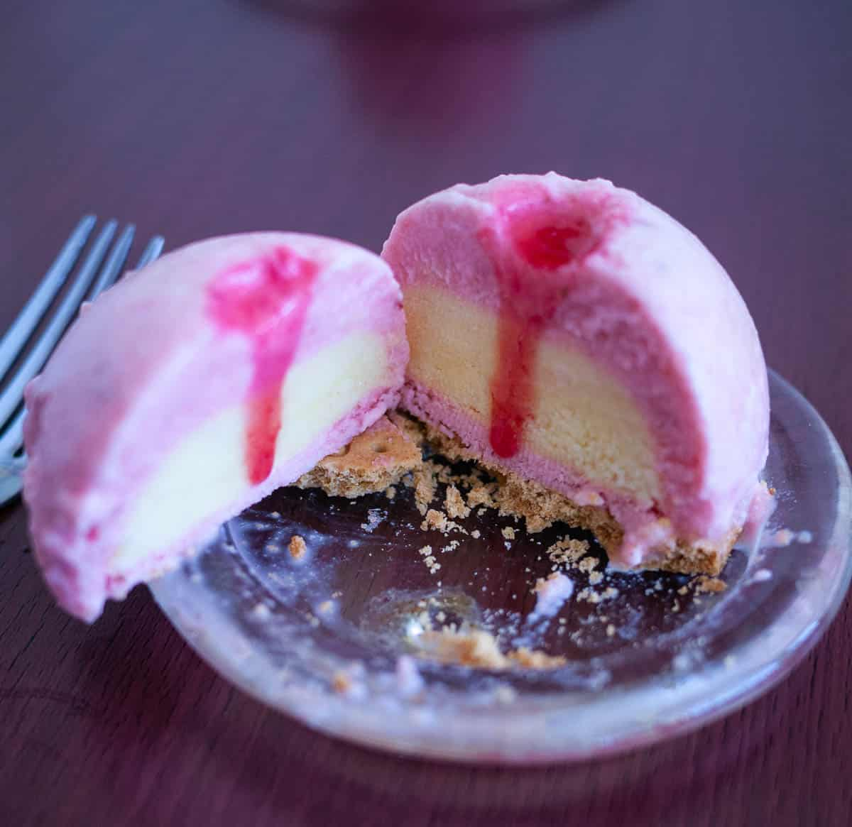 A cut strawberry entremet