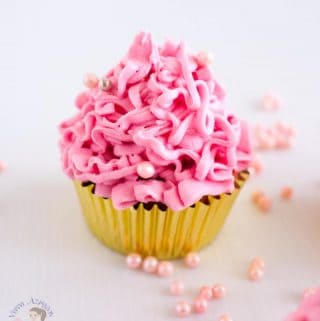 A perfectly baked cupcake is always a treat especially when you make them pretty in pink sprinkled with dragees. This eggless strawberry cupcakes is a simple, easy and effortless recipe to make moist, light and fluffy cupcakes. Topped with the most deliciously rich strawberry flavored buttercream frosting ever.