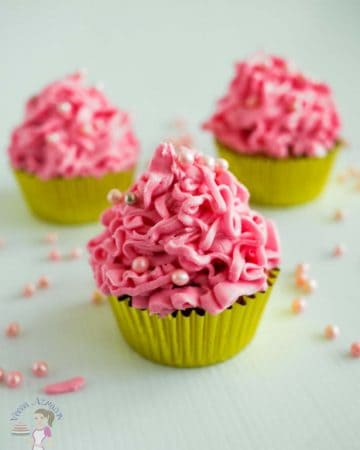 A cupcake with pink frosting.