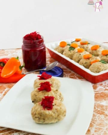 3 pieces of gefilte fish on a plate.