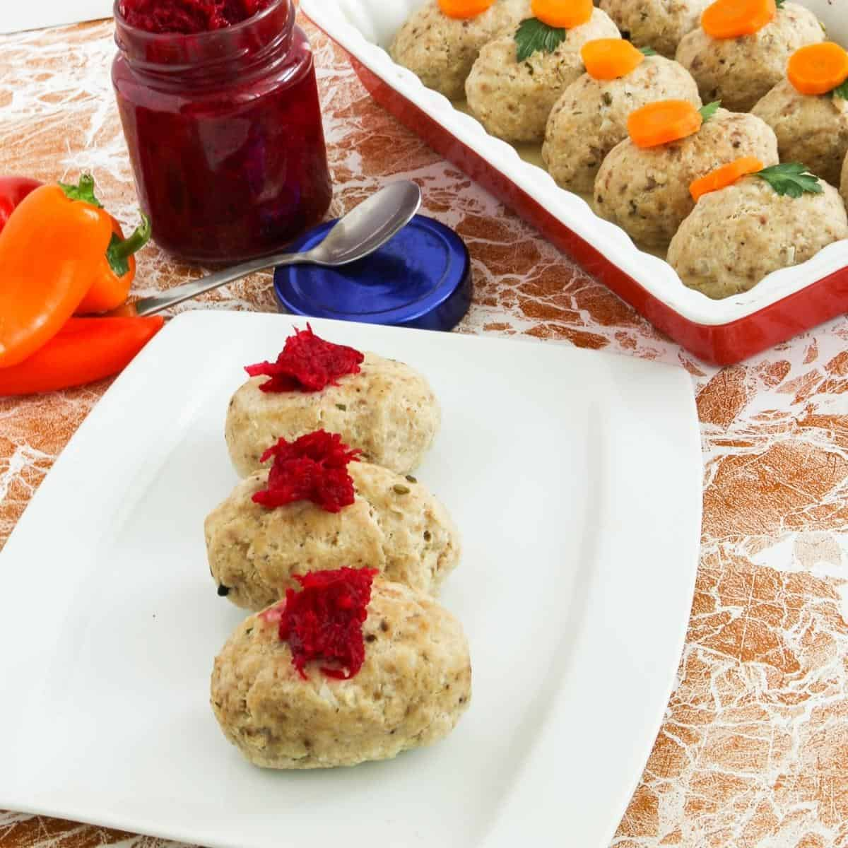 Gefilte fish on a white plate.